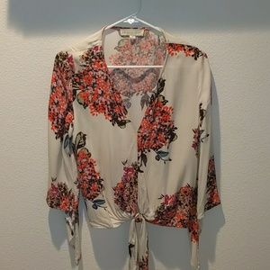 Floral blouse with angled sleeves.